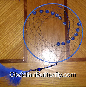 dark blue dream catcher with skulls, from www.ObsidianButterfly.com