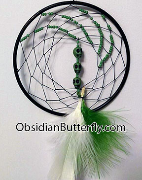 Green and white dreamcatcher, with skulls from www.ObsidianButterfly.com