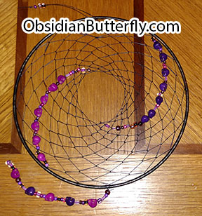 purple and magenta dreamcatcher with skulls, from www.ObsidianButterfly.com