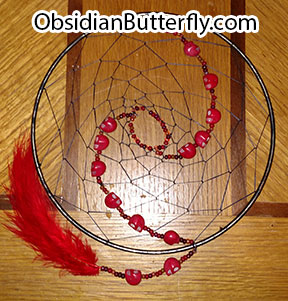 red dreamcatcher with skulls, from www.ObsidianButterfly.com