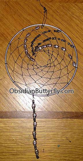 silver dreamcatcher with tiny silver skulls, from www.ObsidianButterfly.com