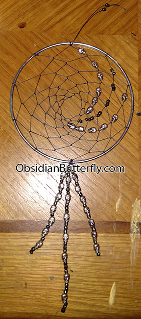 silver dreamcatcher with tiny silver skulls